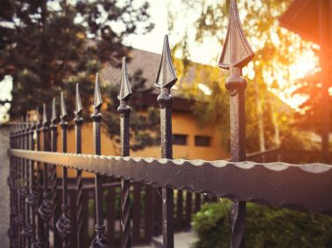 A black, wrought iron fence